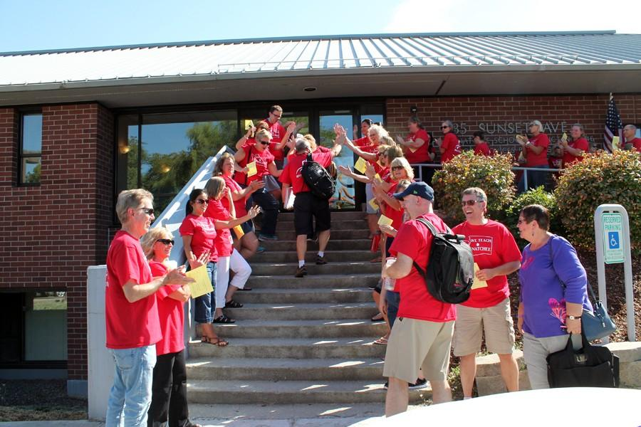 Teachers rally in front of district office in support of teacher union negotiators
