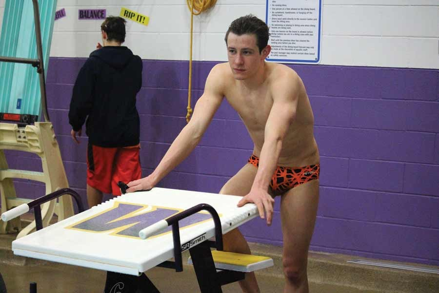 Swimming senior makes waves, breaks records