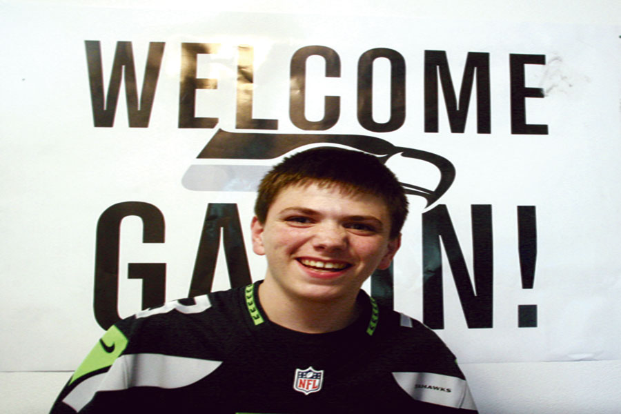 Gavin Zufall stands in front of the welcome poster he received along with many other things during his trip to Seattle. He was invited there after being selected to participate in the Make-A-Wish program. The program grants the wishes of children diagnosed with life-threatening diseases. Zufall met the Seahawks players, went to the zoo, and the Space Needle.
