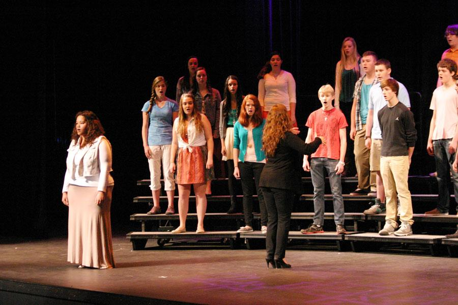 Choir+Director+Dawn+McCormick+leads+the+choir+during+their+performance+of+a+spiritual+to+open+the+assembly.+