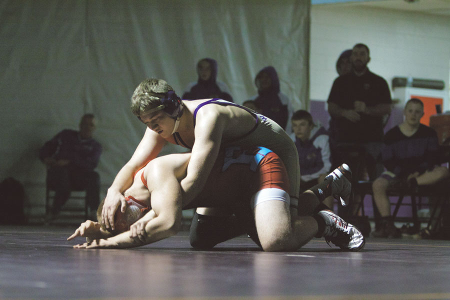 Junior+Elijah+Barnett+takes+down+wrestler+from+Eastmont+High+School+on+Jan.+9.+The+Panthers+lost+32-28%2C+in+part+to+the+loss+of+key+wrestler+junior+Wyatt+Long%2C+causing+a+shuffling+of+Varsity+and+Junior+Varsity+competitors.
