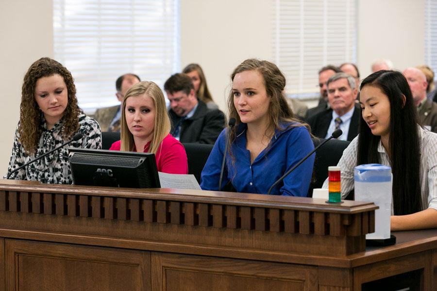 Seniors+Katherine+Robinson%2C+Logan+Brown%2C+Carie+Graves%2C+and+Jackie+Bollinger+present+at+a+public+hearing+on+Jan.+30.+