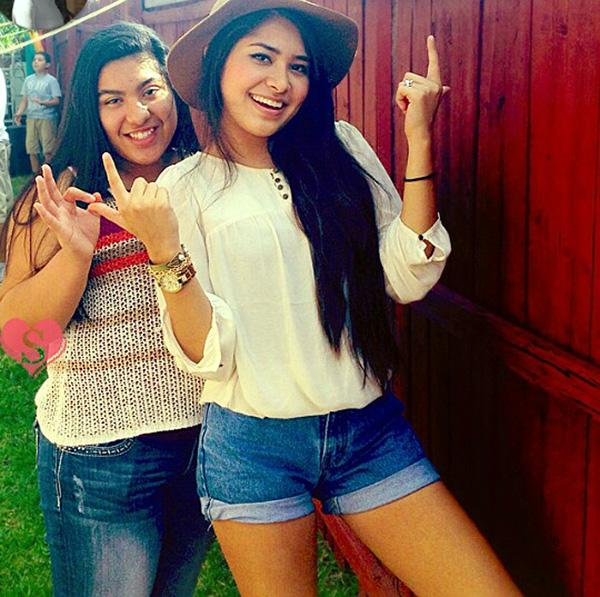 Flashing a smile for the camera, freshman Angela Avalos and her cousin Alejandra Magdaleno are reunited every year in Avalos' annual trip to texas to visit her family.