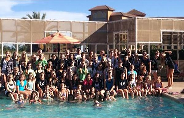 The 2013-2014 Dance Creations Nationals crew poses in front of the pool at the Hyatt Hotel in Anaheim, where the group performed on the Nationals dance competition stage after months of intense practice.