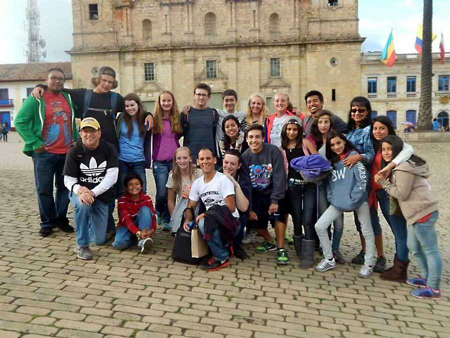 Senior Miles Letts-Brandt takes a photo with the group members of his mission trip in Bogota, Colombia along with their team of native Colombian members.