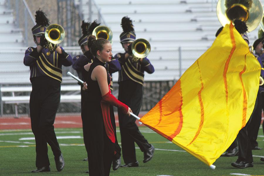 The+Wenatchee+High+School+GA+Band+color+guard+performs+with+fellow+band+members+on+Oct.+4+in+Pasco.