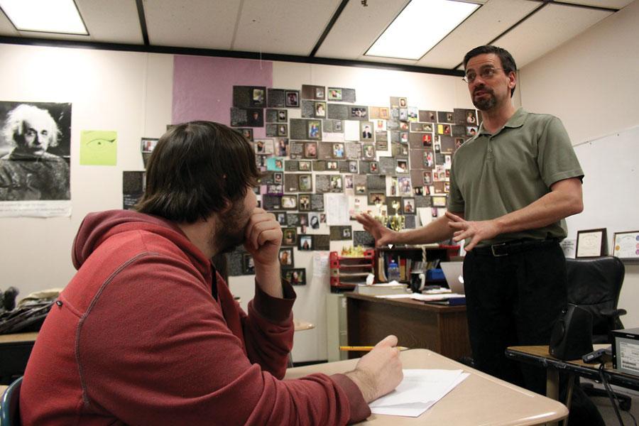 Debate coach and English teacher Dave Carlson teaches his sixth period class on Wednesday.