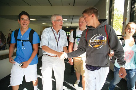 Principal Bob Celebrezze shakes hands with a student during his first month as principal at Wenatchee High School in 2013.