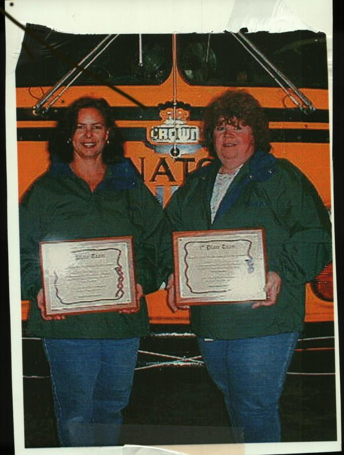 Vaneen McIntosh stands with her fellow bus driver Kay Jefferson after winning a national competition. Photo credit: Wenatchee High School transportation department.