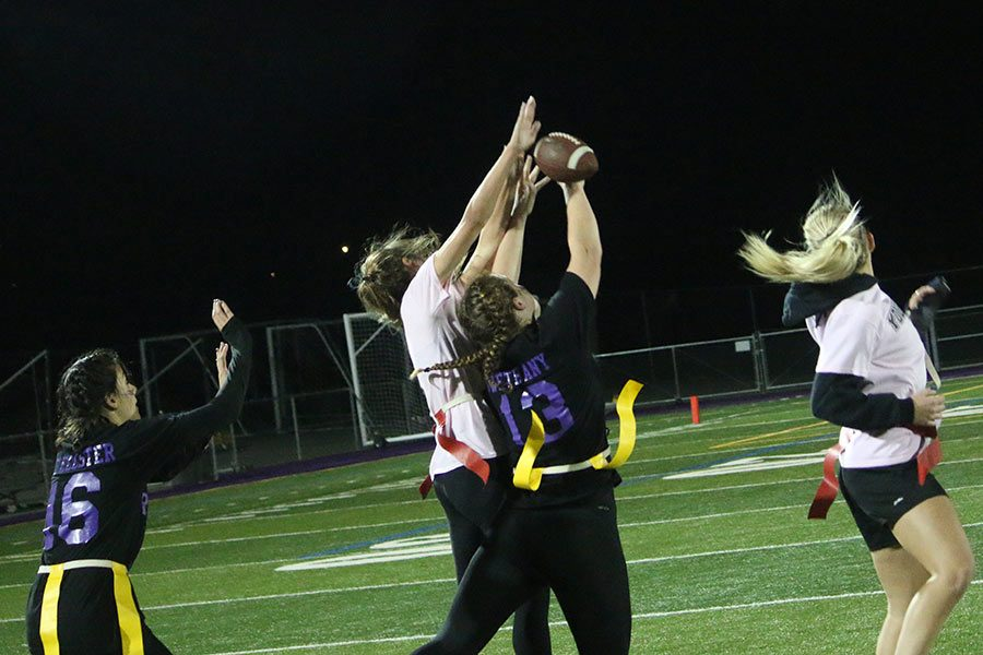 Junior Allie Rader (in white) goes up to catch a pass.