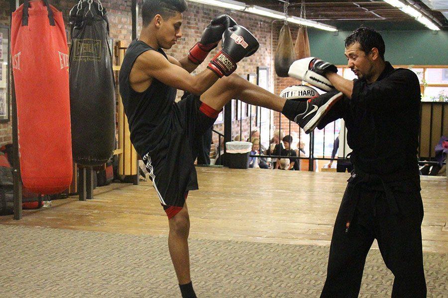 Junior Marc Hernandez boxes with his coach Omar Padilla at Ki Fighting Concepts.