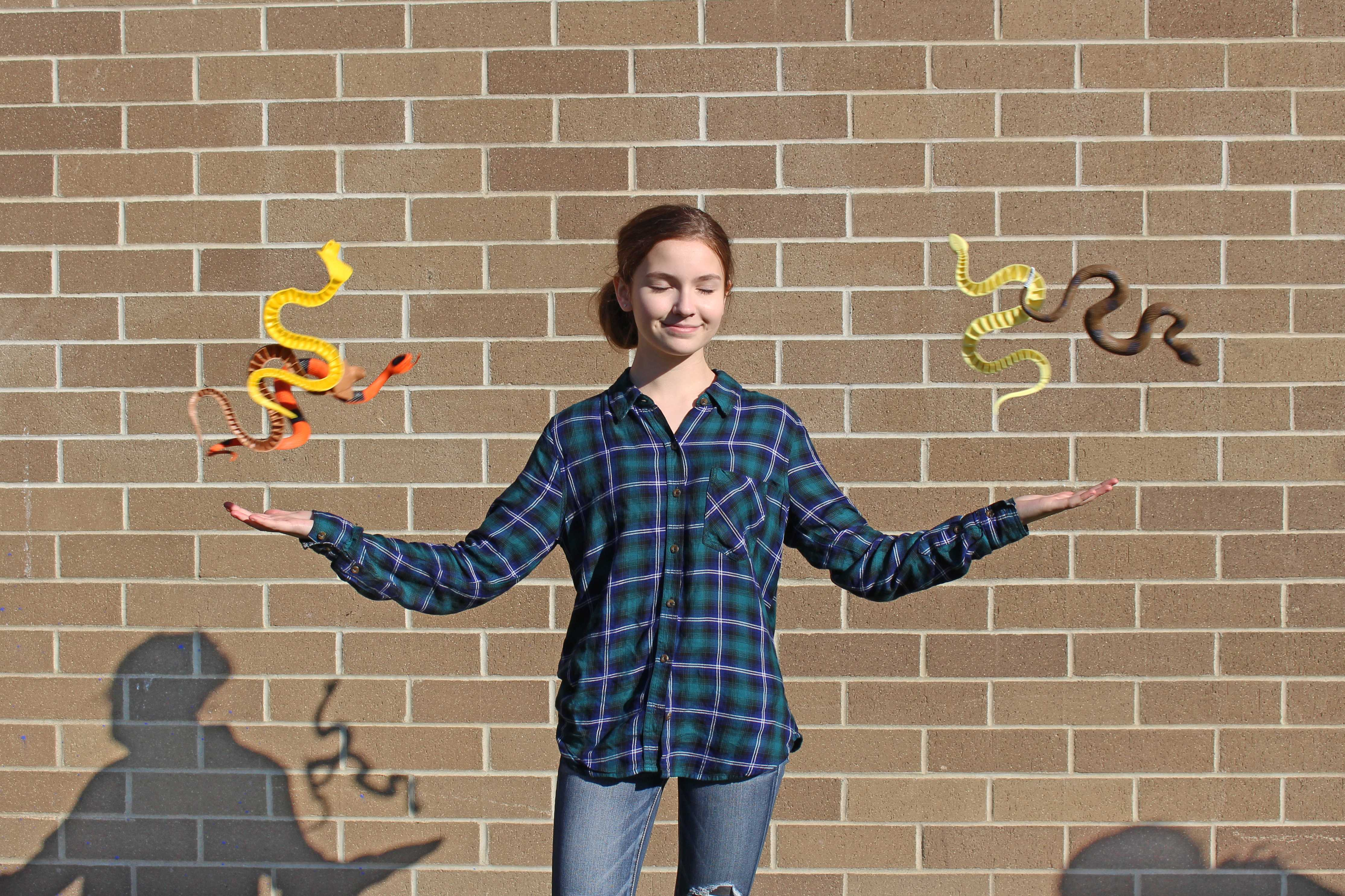 Sophomore Olive Ryan hangs out with her fellow snakes.