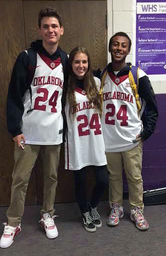 Sophomore Gavin Woodring, Junior Allie Rader, and Noah Holland rock Buddy Hield jerseys.