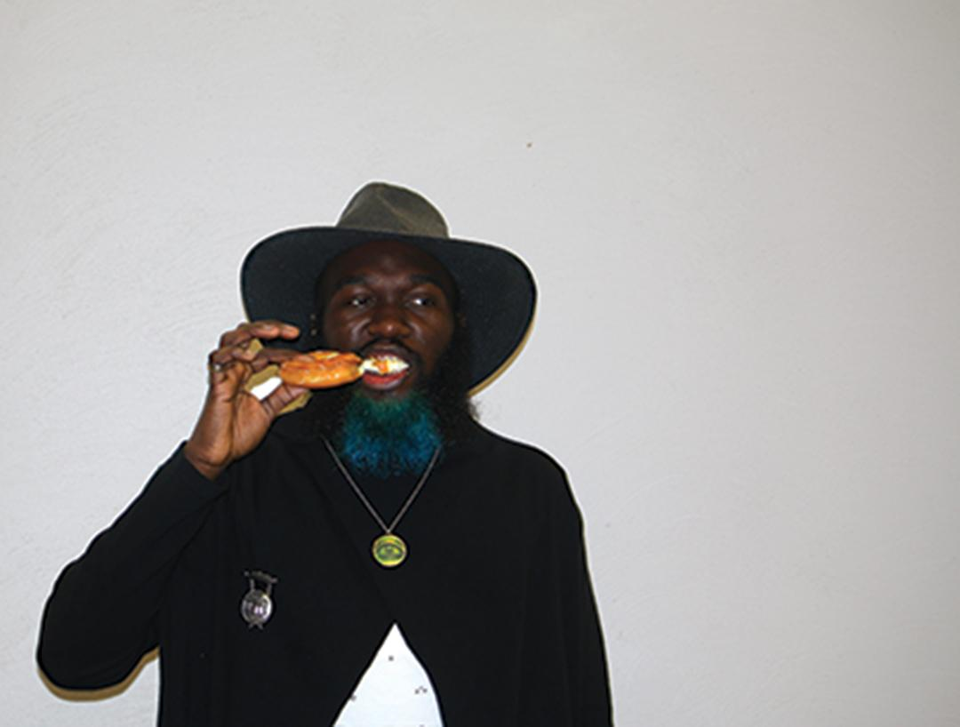Substitute teacher Deandre Lester chows down on a croissant.