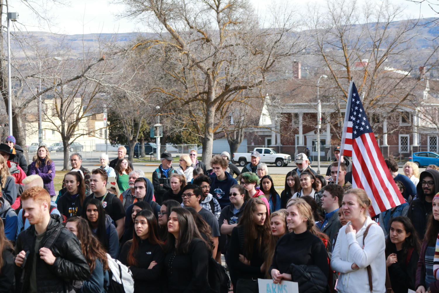 Students gather at Memorial Park to commemorate the seventeen students lost in Parkland, Florida.