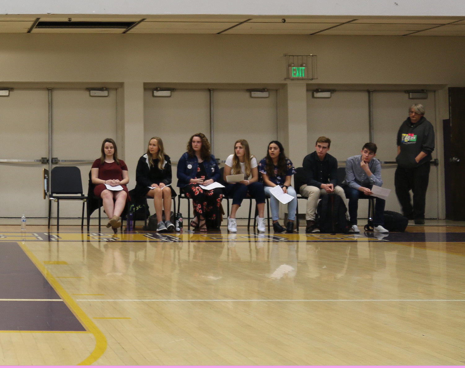 ASB  executive candidates listen to a campaign speech